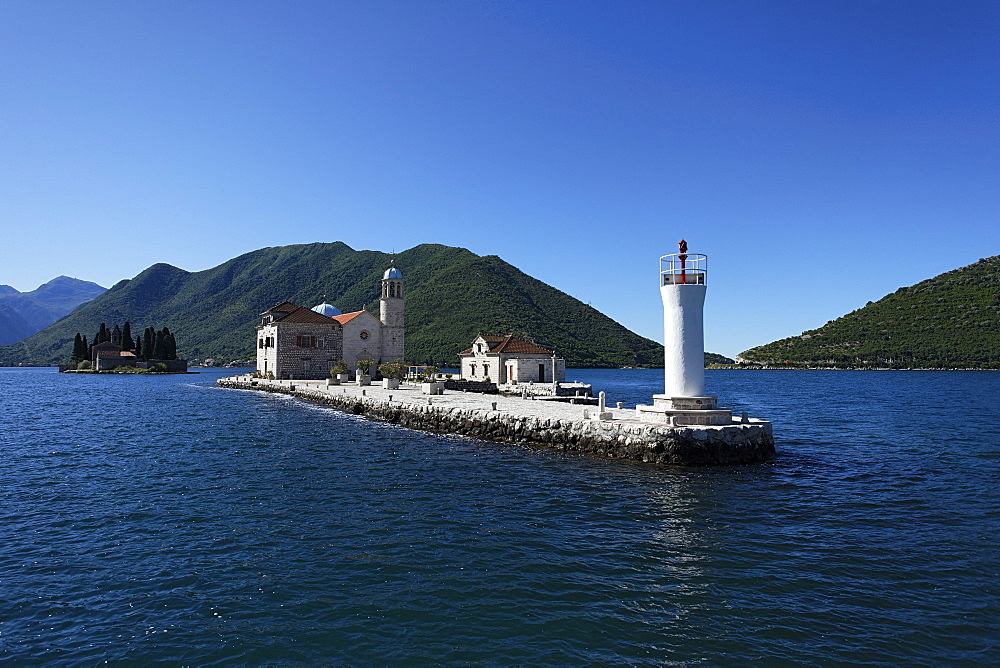 Church on the Island of Gospa od Skrpjela in the sunlight, Perast, Bay of Kotor, Montenegro, Europe
