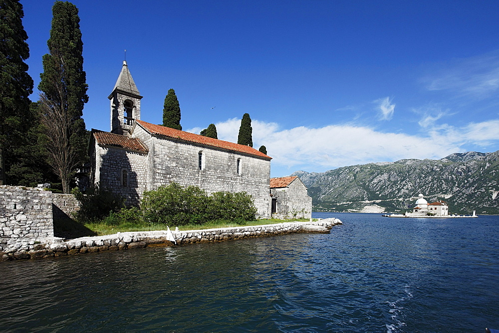 Church on the Island of Gospa od Skrpjela, in the background Sveti Dorde Island, Perast, Bay of Kotor, Montenegro, Europe