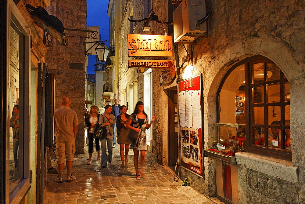 People on an alley of the old town in the evening, Budva, Montenegro, Europe
