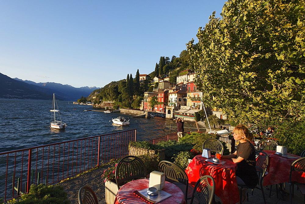 Woman drinking juice, Varenna, Lake Como, Lombardy, Italy