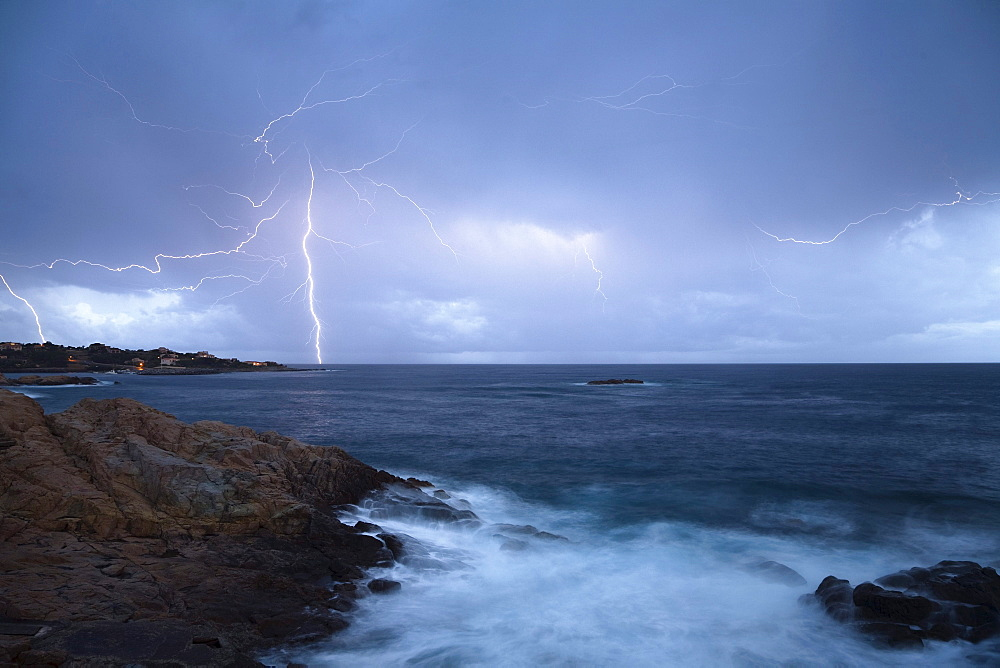 Thunderstorm and surf in Algajola Bay, North-west coast, Balagne region, Corsica, France, Europe