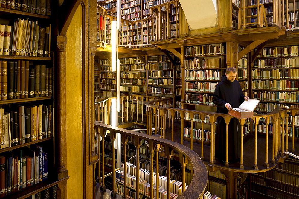 Monk at the library at Maria Laach abbey, Eifel, Rhineland-Palatinate, Germany, Europe