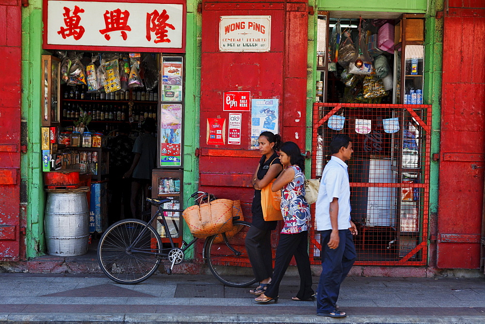 Street scene, people in front of a shop at rue de la Reine, Port Louis, Mauritius, Africa
