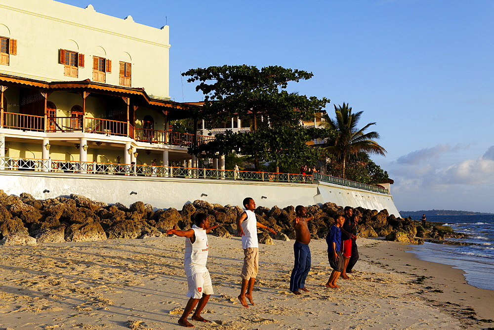 Children doing beach gymnastics in front of the Serena Inn hotel, Stonetown, Zanzibar City, Zanzibar, Tanzania, Africa
