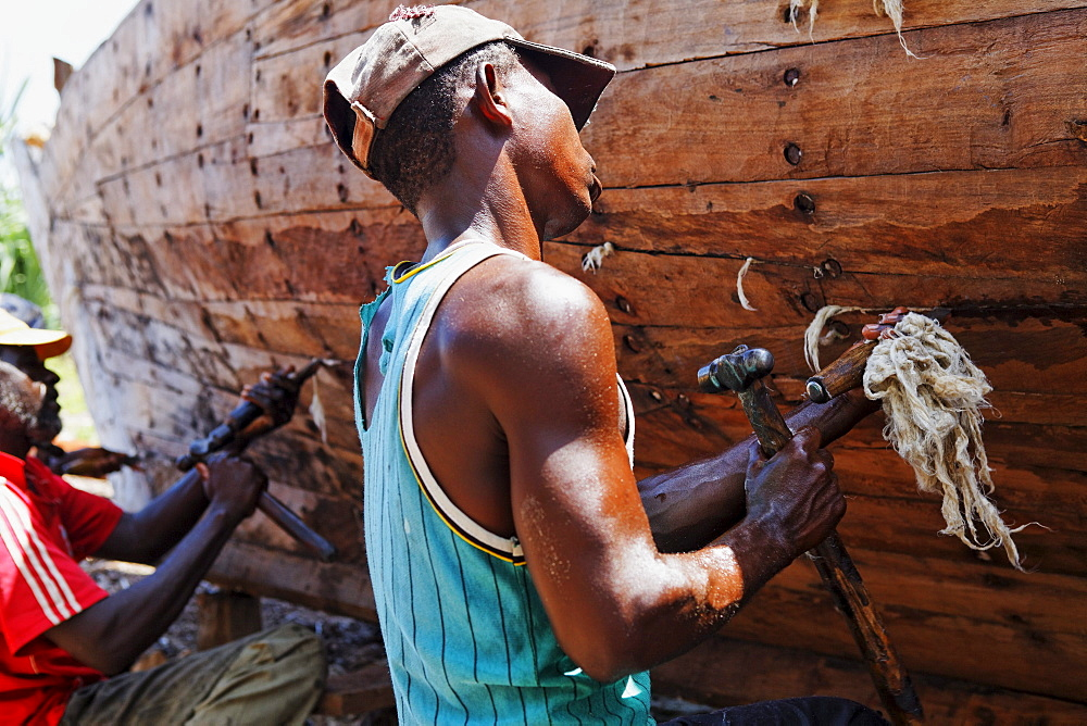 Workers at Dhow construction company in the village Nungwi, Zanzibar, Tanzania, Africa