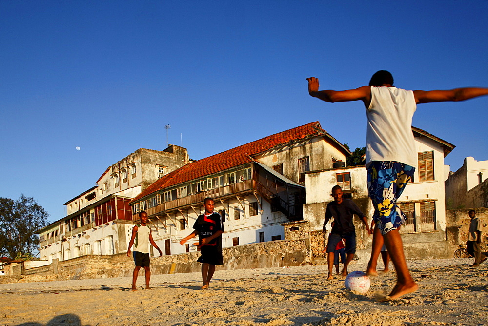 Children playing soccer on the beach of Stonetown, Zanzibar City, Zanzibar, Tanzania, Africa - 1113-44836