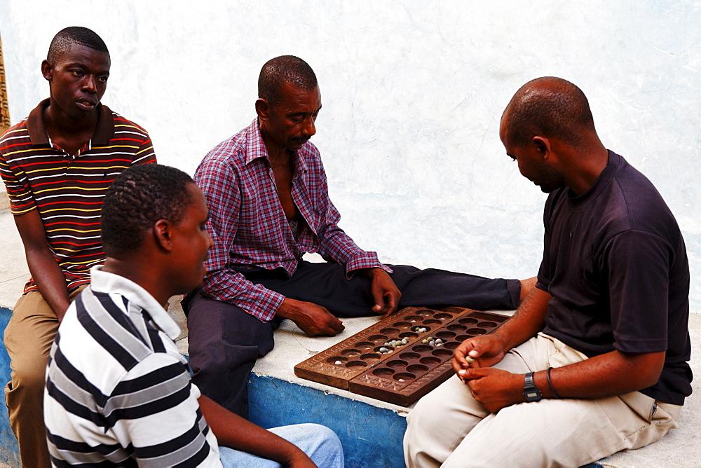 Local men playing Bao, Stonetown, Zanzibar City, Zanzibar, Tanzania, Africa