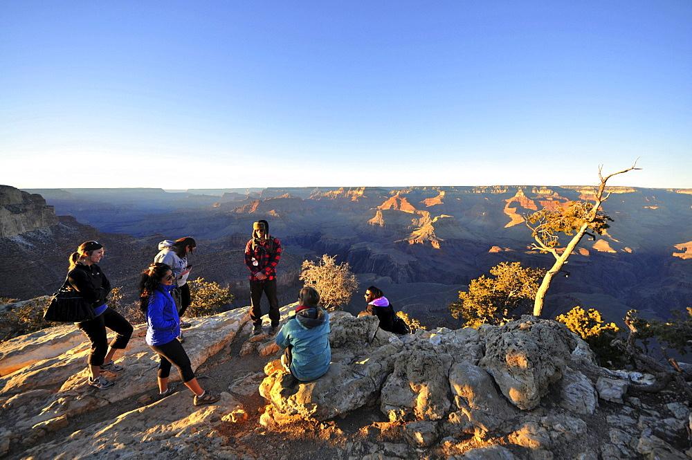 People at South Rim at sunset, Grand Canyon, Arizona, southwest USA, America