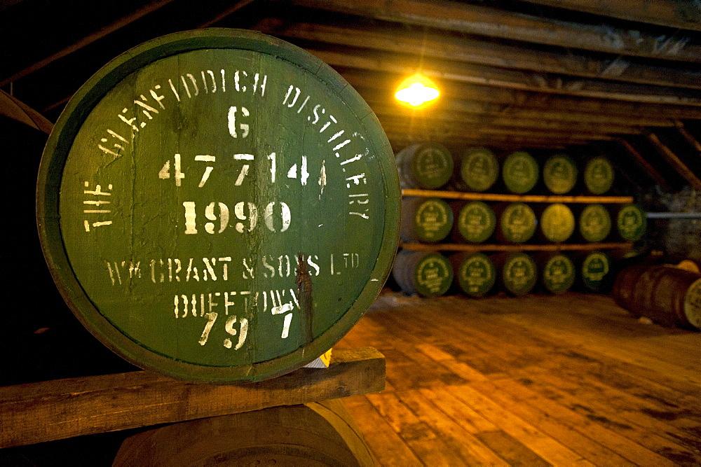 Warehouse full of oak barrels at the Glenfiddich Destillery, Dufftown, Aberdeenshire, Scotland