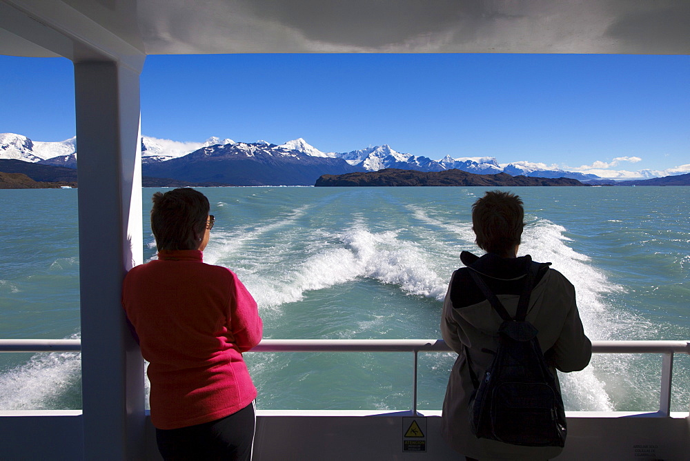 Two women on board a ship on the passage to the glaciers at Lago Argentino, Los Glaciares National Park, near El Calafate, Patagonia, Argentina