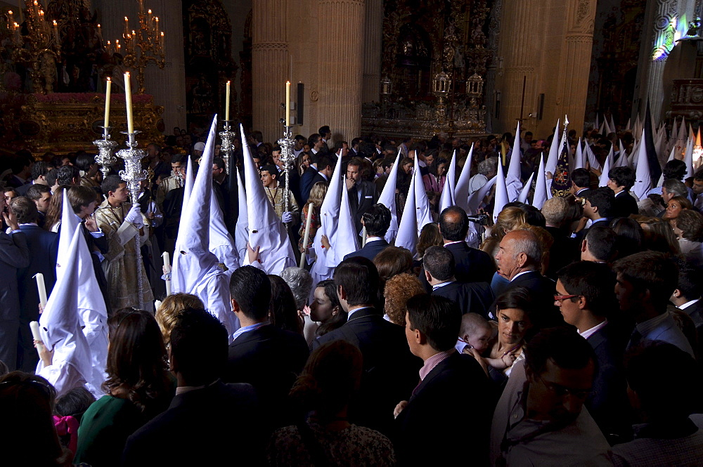 Nazarenos of the brotherhood La Borriquita at the church El Salvador on Palm Sunday, Semana Santa, Sevilla, Andalusia, Spain, Europe
