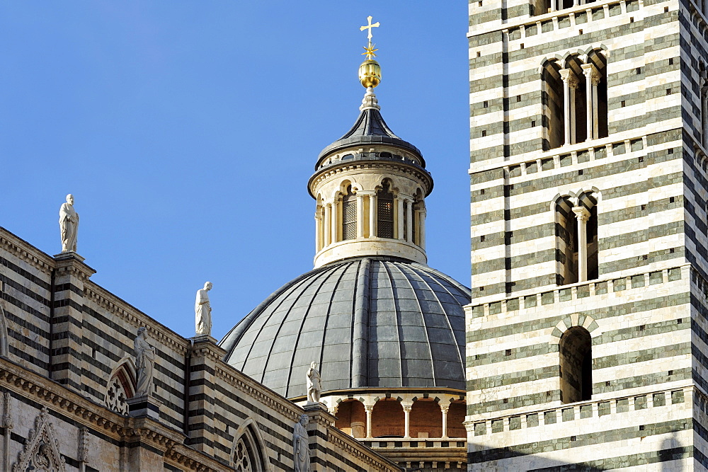 Facade of Siena cathedral with dome and spire, Siena, UNESCO World Heritage Site Siena, Tuscany, Italy