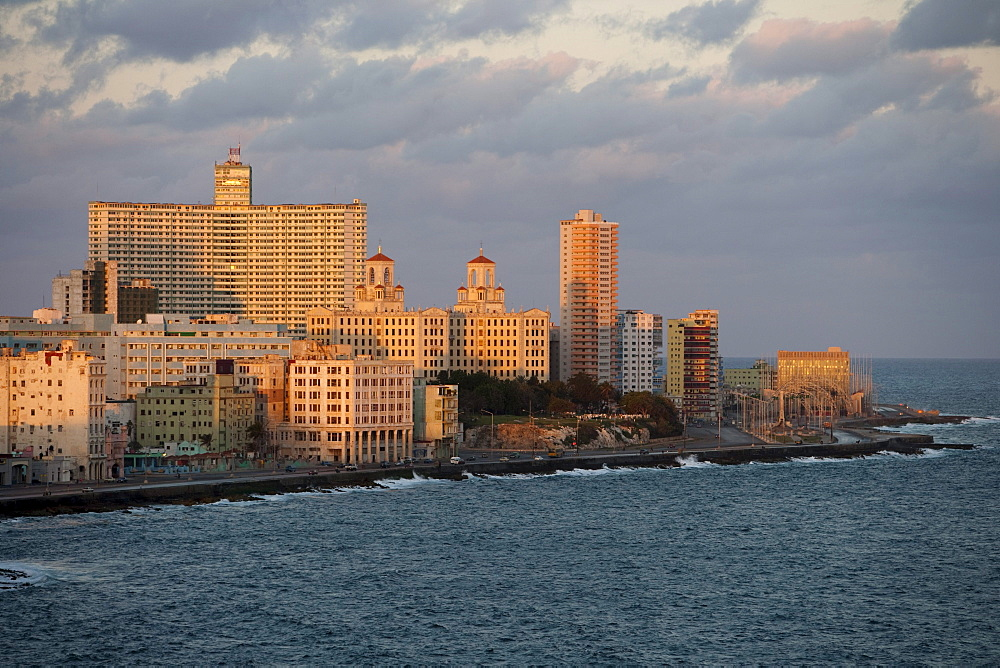 Buildings, Hotel Nacional in the center and Malecon sea drive at sunrise, City of Havana, Havana, Cuba