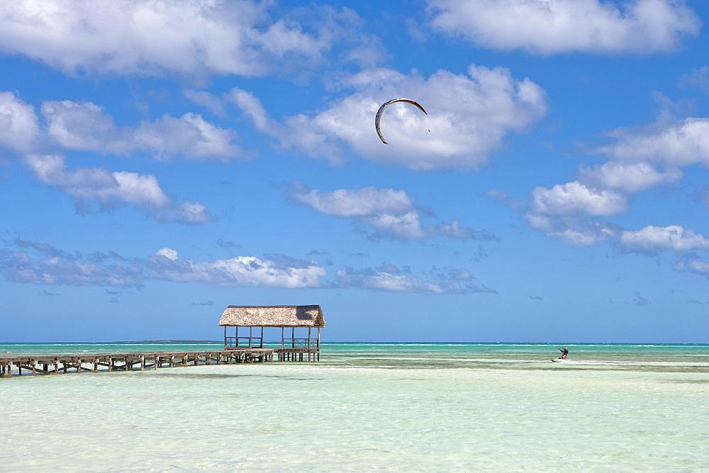 Pier and kitesurfer in lagoon, Cayo Guillermo (Jardines del Rey), Ciego de Avila, Cuba