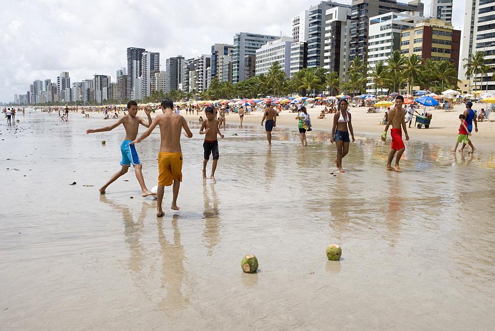 Boys playing beach soccer with coconut goal posts, Recife, Pernambuco, Brazil, South America