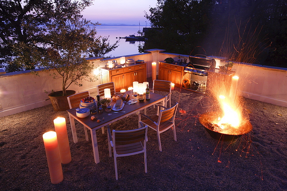 Outdoor kitchen and firepot, Lake Chiemsee, Chiemgau, Bavaria, Germany