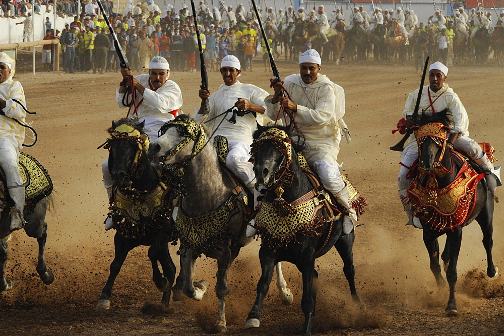 Men on horseback carrying guns, Fantasia festival for the Moussem of Moulay Abdallah near el-Jadida, Atlantic Coast, Morocco, Africa