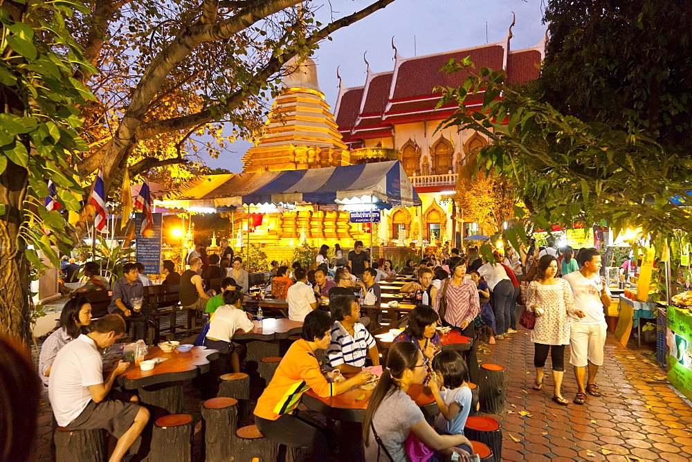 People at tables of restaurants at the night market, Chiang Mai, Thailand, Asia