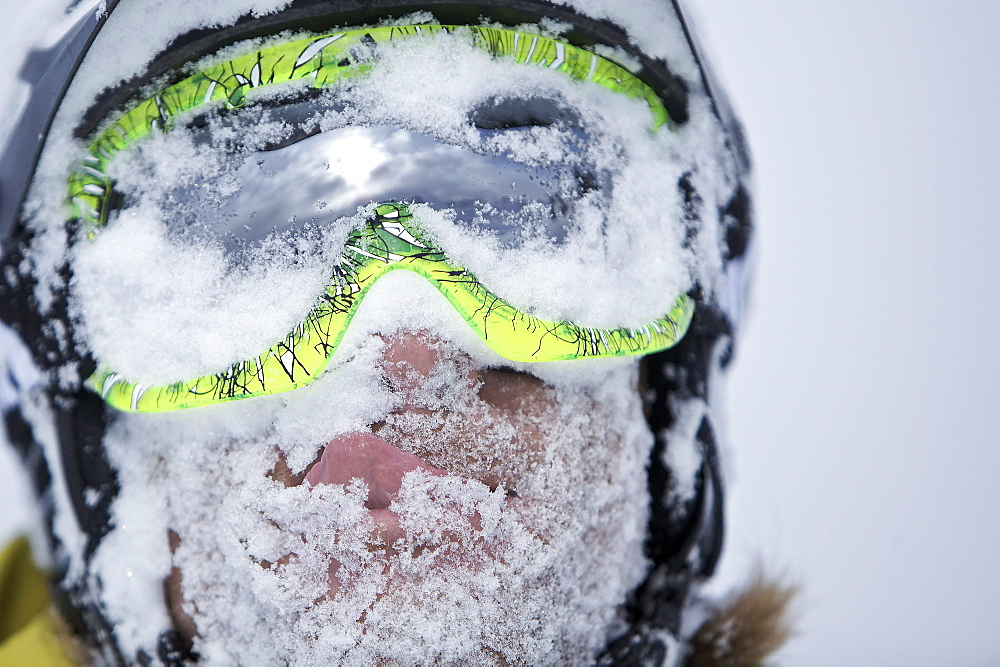 Snow-covered face of a snowboarder, Chandolin, Anniviers, Valais, Switzerland