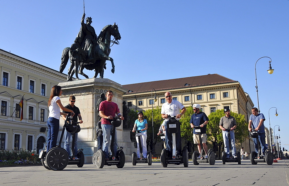 People on segways during a guided tour at the monument of Ludwig I, Ludwigstrasse, Munich, Bavaria, Germany, Europe
