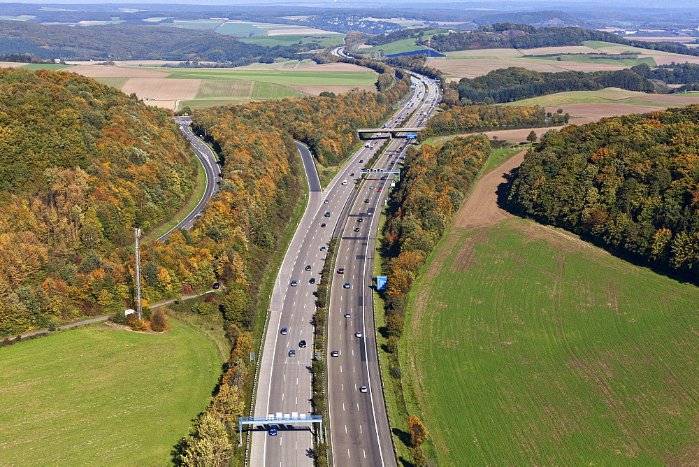 Aerial view of motorway A 48 in autumn, Eifel, Rhineland Palatinate, Germany, Europe
