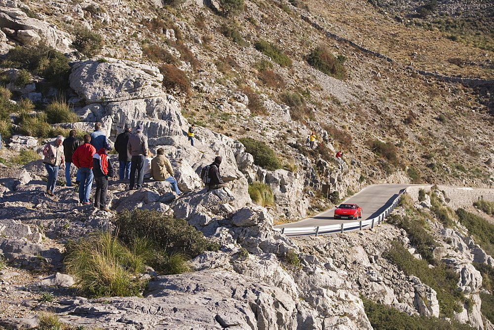 Spectators and Ferrari on Sa Calobra Mountain Road, Rally Classico Isla Mallorca, near Cala de Sa Calobra, Mallorca, Balearic Islands, Spain