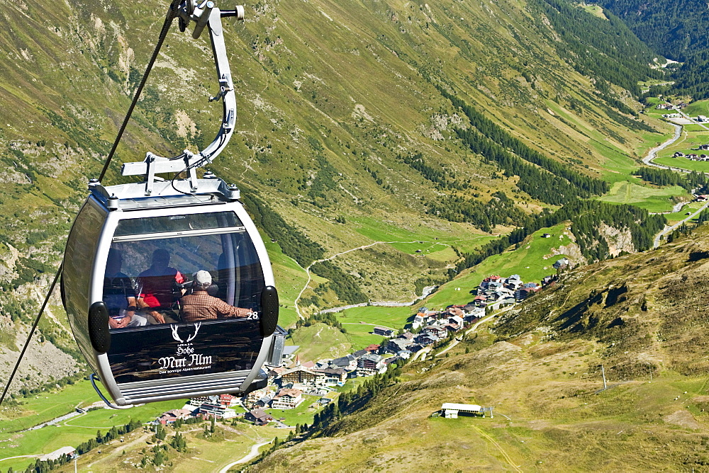 People in a passenger cabin above a valley, Obergurgl, Oetztal Alps, Tyrol, Austria, Europe