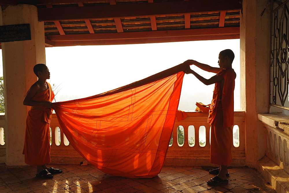 Buddhist monks, novices, cladding their robes, Phu Si hill, Luang Prabang, Laos