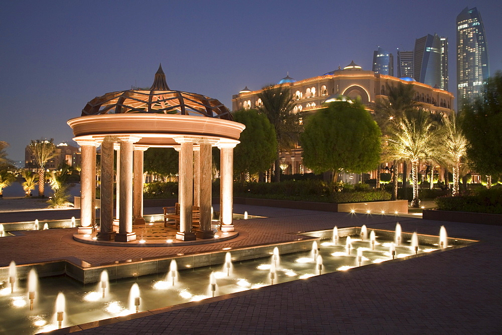Pavillion and fountains of Emirates Palace hotel at dusk, Abu Dhabi, United Arab Emirates