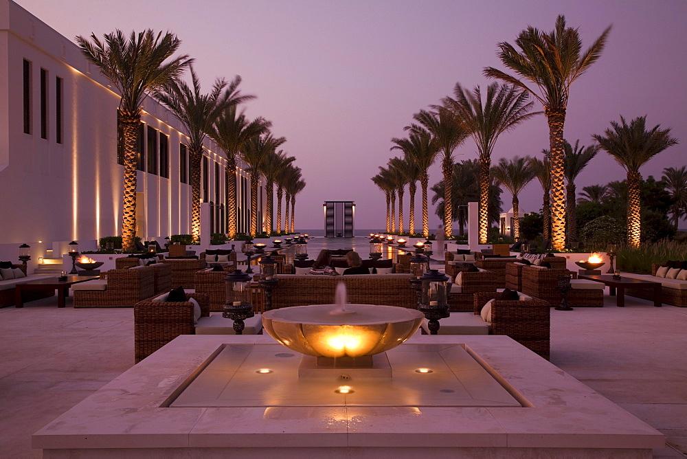 The Long Pool, The Chedi Muscat hotel at dusk, Muscat, Masqat, Oman, Arabian Peninsula