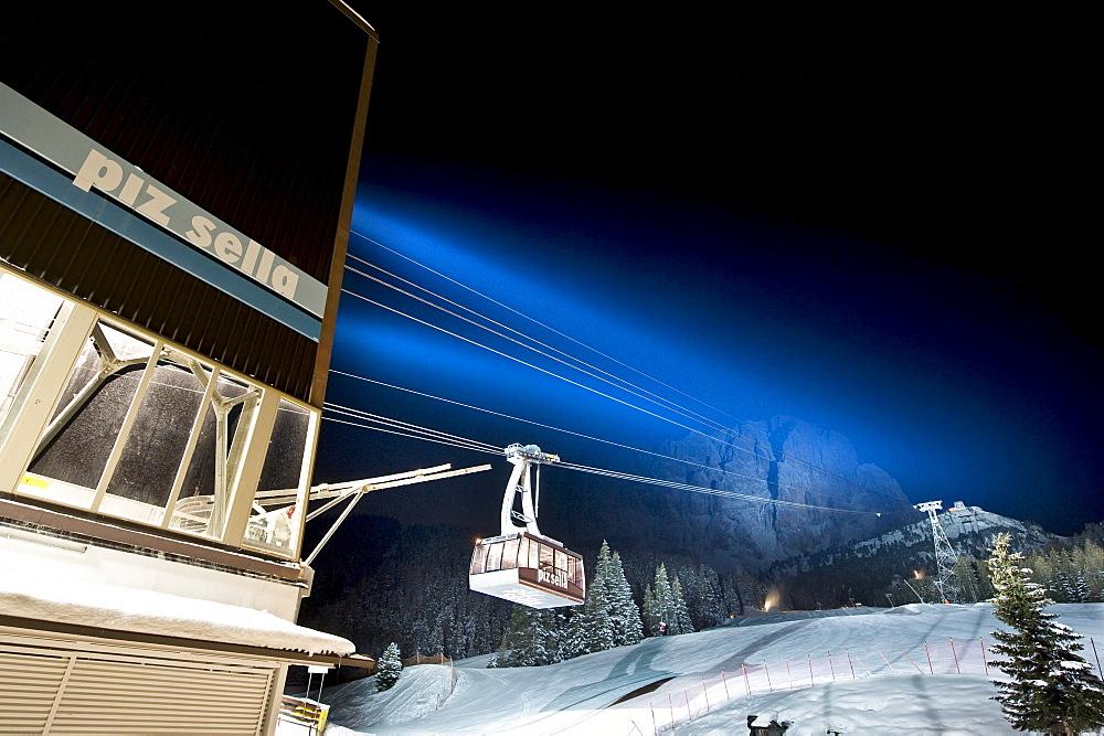 Illuminated cable car above ski slope at night, Sella, Alto Adige, South Tyrol, Italy, Europe