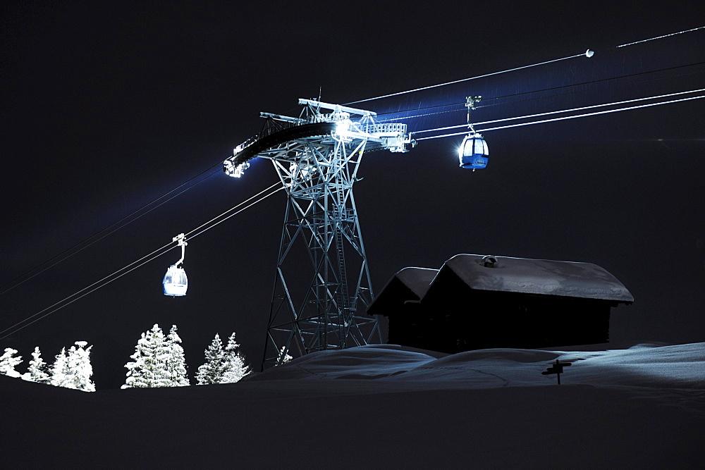 Illuminated cable car above ski slope at night, Alpe di Siusi, Valle Isarco, Alto Adige, South Tyrol, Italy, Europe