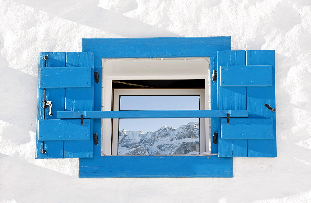 Reflection of snowy mountains on a window pane, Alto Adige, South Tyrol, Italy, Europe