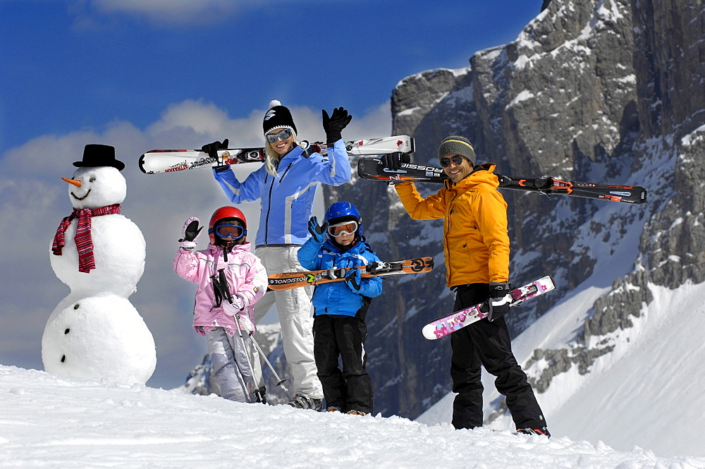 Waving family with skiing equipment, Alto Adige, South Tyrol, Italy, Europe