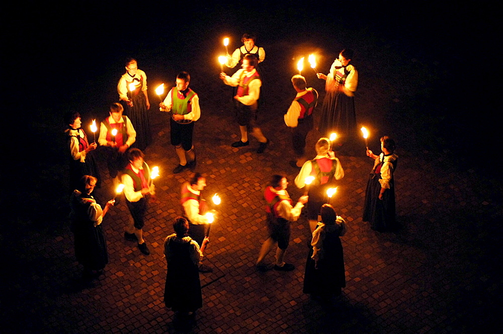 South Tyrol traditional dancing with torches, Alto Adige, South Tyrol, Italy