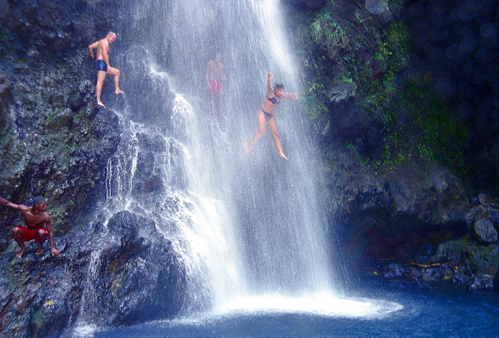 Woman jumping in waterfall, Falls of Balleine, St. Vincent, Caribbean, America