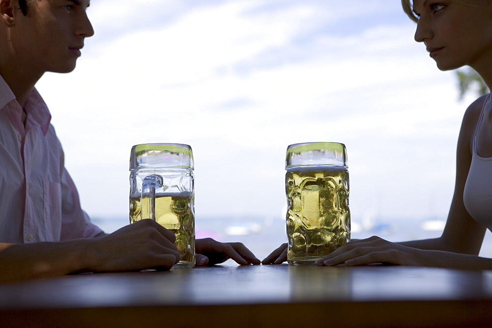 Two young adults in beergarden near Lake Starnberg, Bavaria, Germany