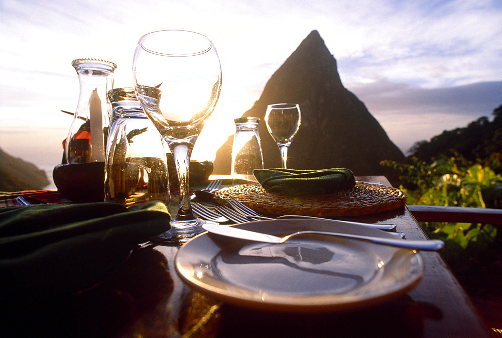 A table is laid on the terrace of the Restaurant Dasheene at sunset, Soufriere, St. Lucia, Carribean