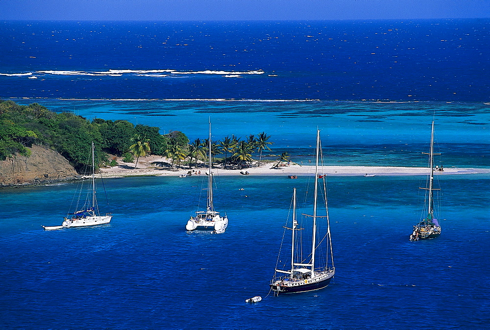 Sailing boats anchoring in a bay at Horseshoe Reef, Tobago Cays, St. Vincent, Grenadines, Caribbean, America