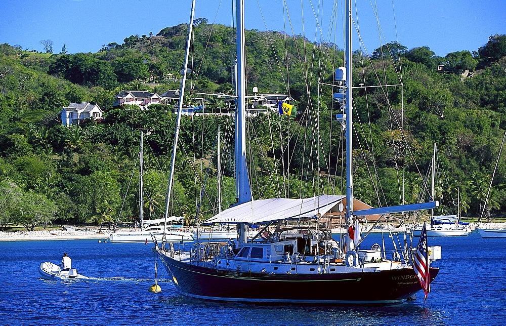 Sailing boat at Britania Bay off Mustique island, St. Vincent, Grenadines, Caribbean, America