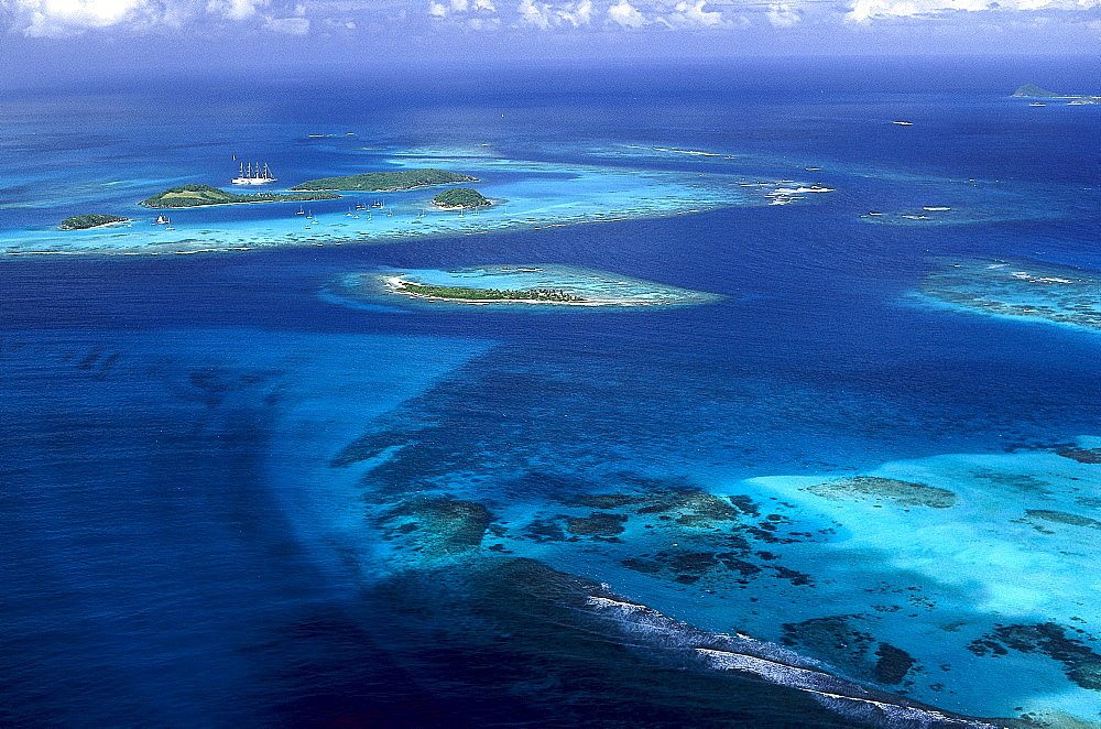 Aerial view of the archipelago Tobago Cays under clouded sky, Grenadines, Caribbean, America