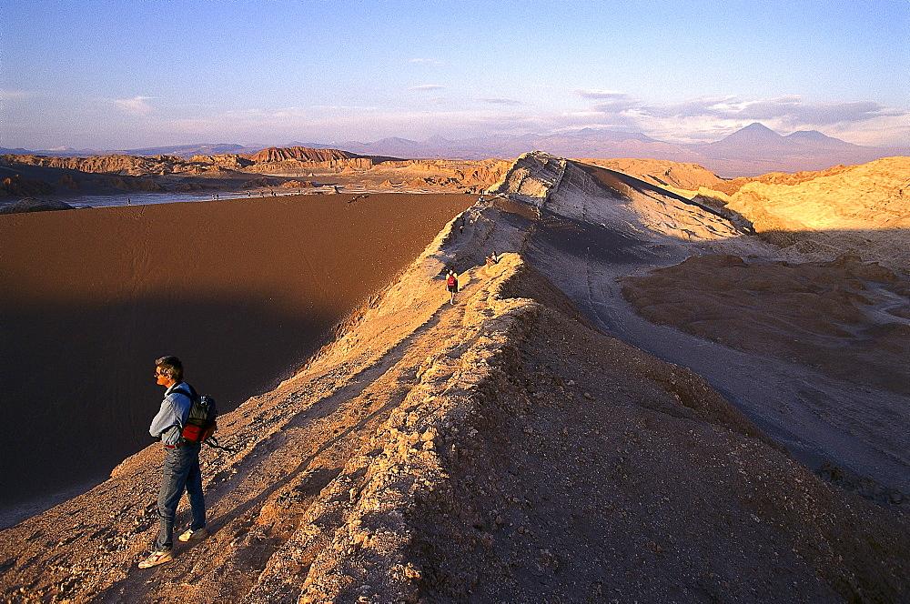 Hikers in the desert in the light of the evening sun, Valle de la Luna, Atacama desert, Chile, South America, America