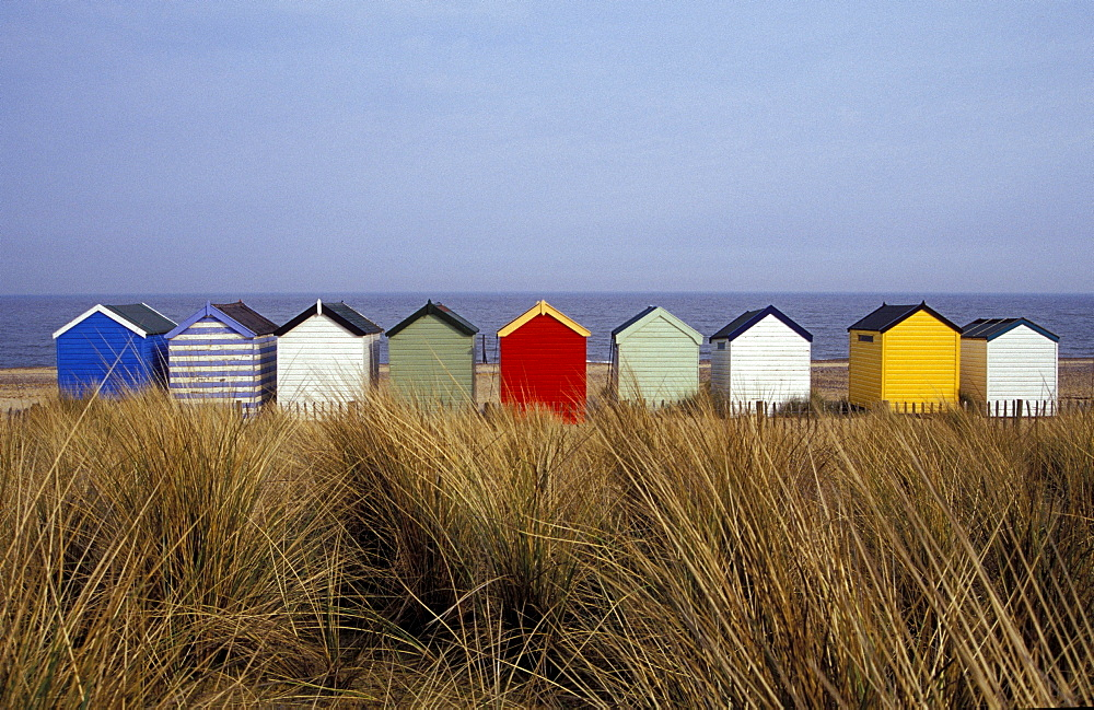 A line of colourful beach huts, Southwold, East Anglia, England
