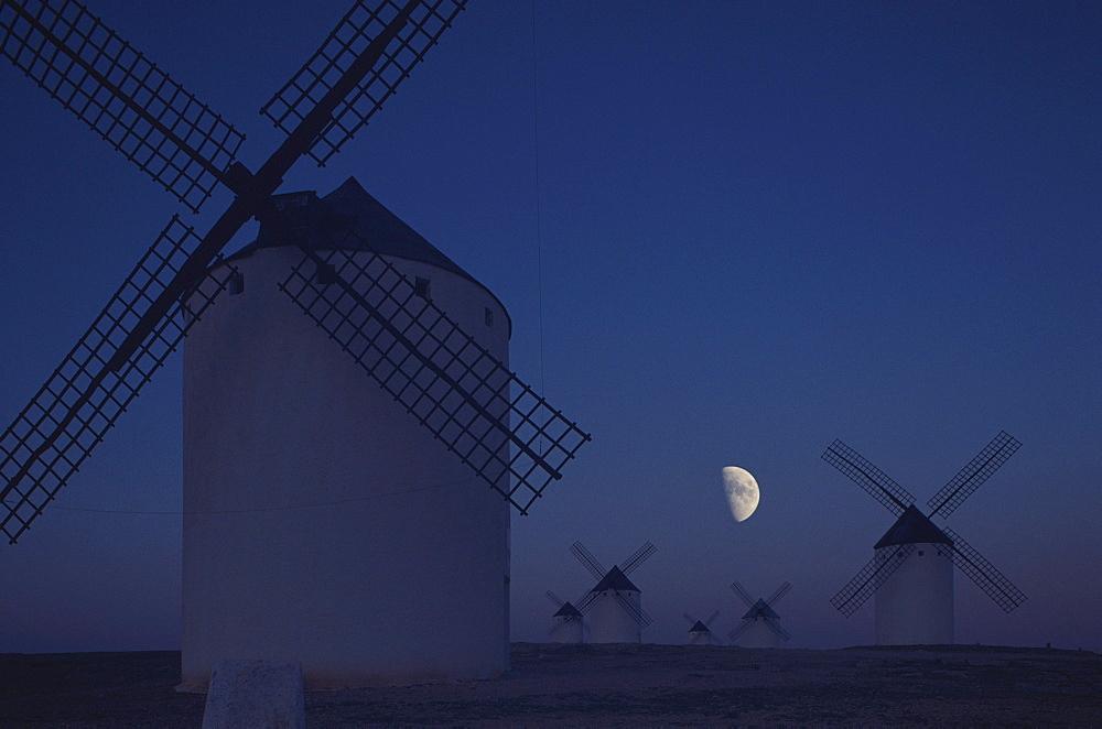 Windmills in the moonlight at night, La Mancha, Castile, Spain, Europe