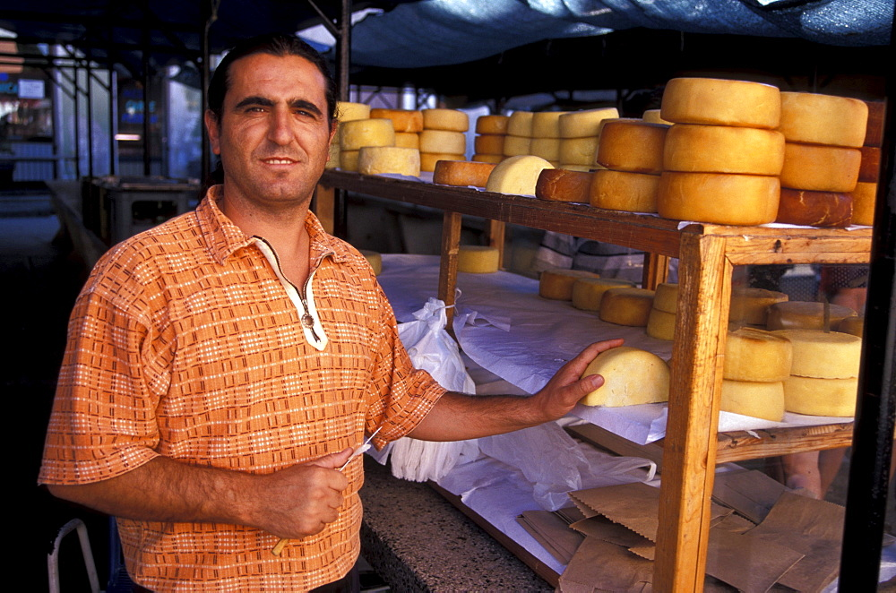 Man selling cheese at the market, Rovinj, Istria, Croatia, Europe