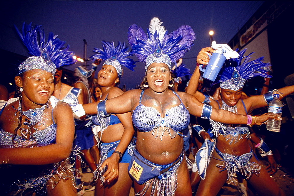 Women in costumes dancing at Mardi Gras, Port of Spain, Trinidad and Tobago, Caribbean