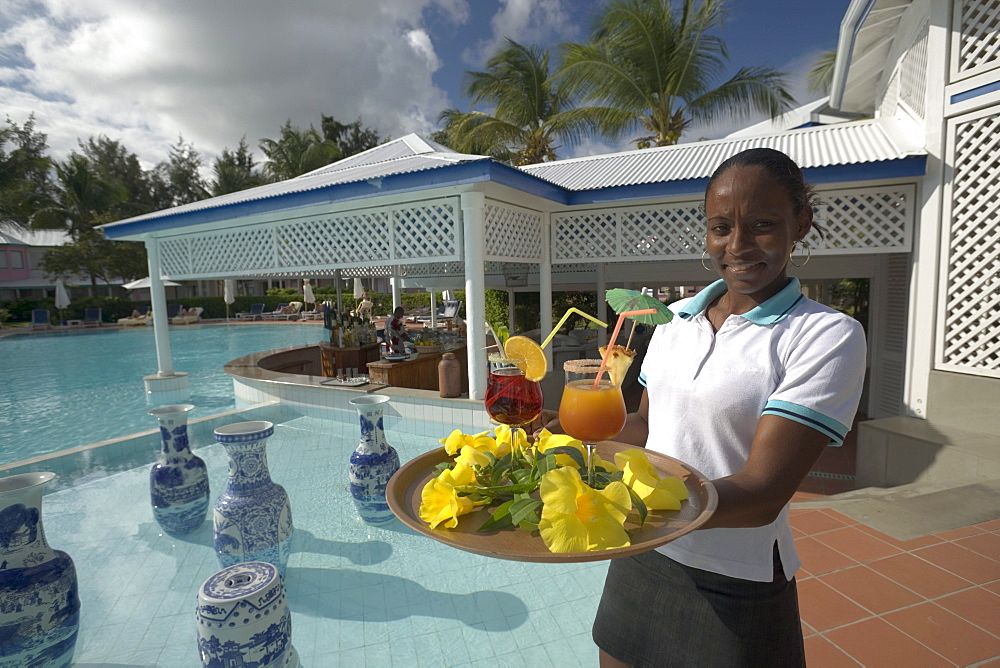 Waitress serving Planters Punch at Hotel La Cocoteraie, Le Meridien, Saint-Francois, Guadeloupe, West Indies