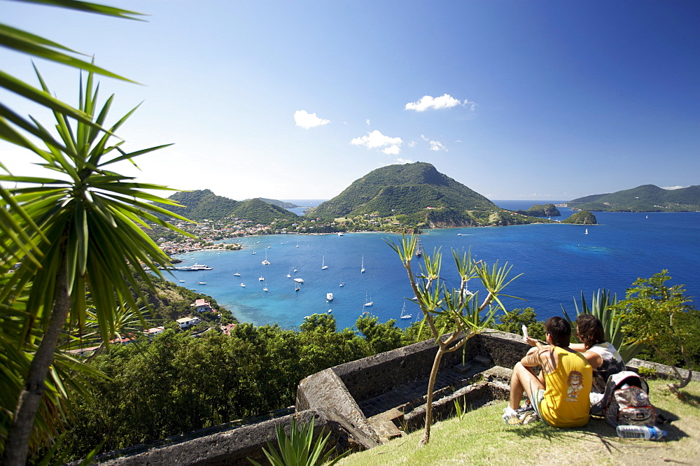 Panoramic view, Couple admiring the view, Fort Napoleon, Terre-de-Haute, Les Saintes Islands, Guadeloupe, Caribbean Sea, America