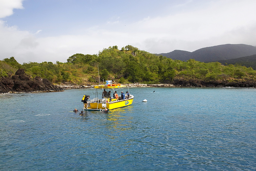 People on a boat of the diving school off shore, Bouillante, Basse-Terre, Guadeloupe, Caribbean Sea, America