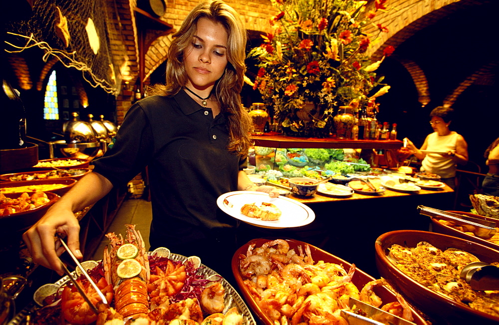 Young young woman with a plate, Buffet, Recife, Pernambuco, Brazil